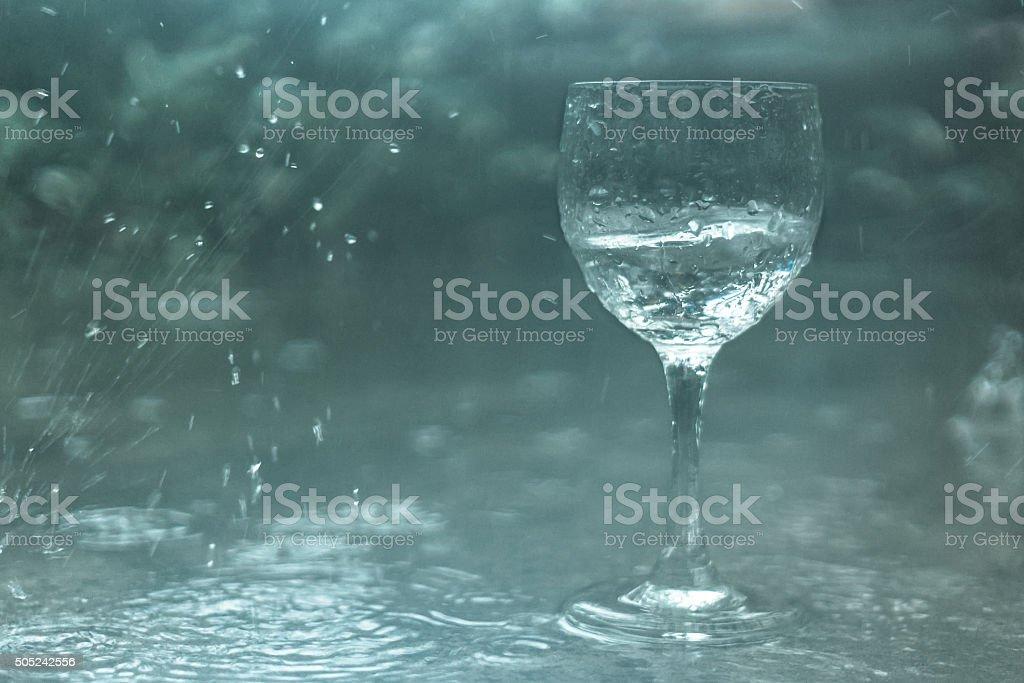 Wine glass in the rain stock photo