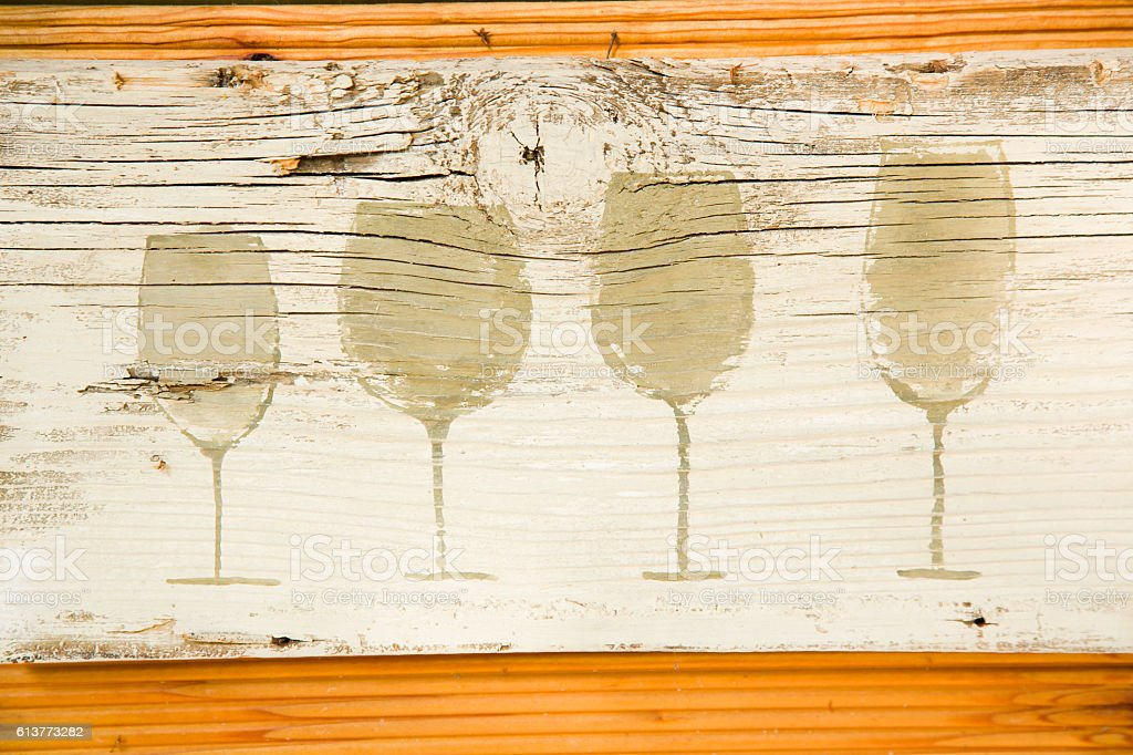Wine glass silhouettes painted on board. Decoration of bar. stock photo
