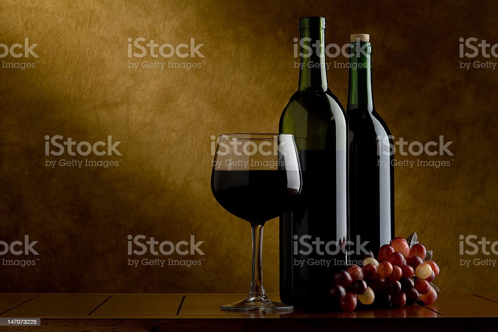 Wine glass,  two bottles and grapes royalty-free stock photo