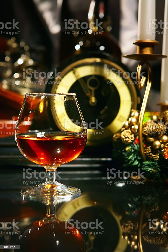 wine glass with cognac in christmass decorations stock photo