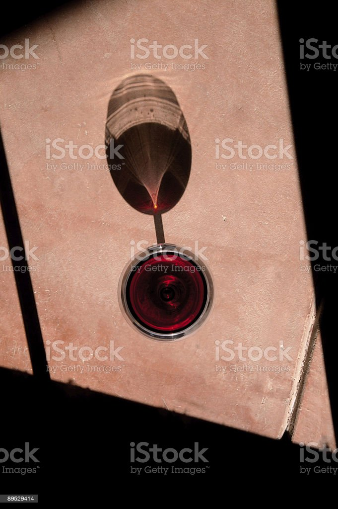 Wine Glass with Dramatic Shadow royalty-free stock photo