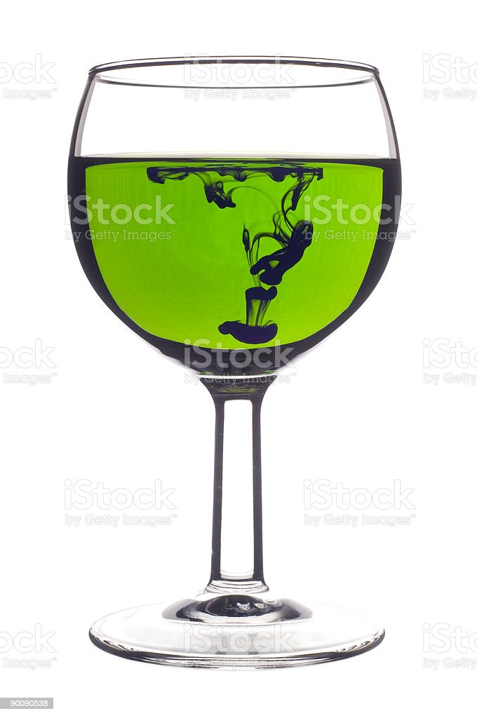 Wine glass with green mixing liquids royalty-free stock photo