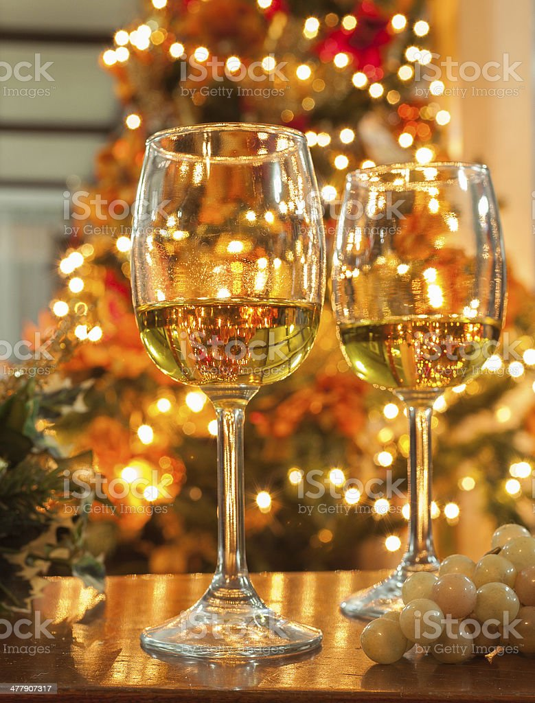 Wine Glasses against Christmas Lights royalty-free stock photo