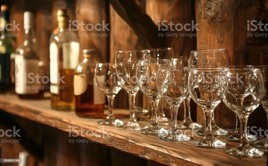wine glasses and bottles on a shelf retro stock photo