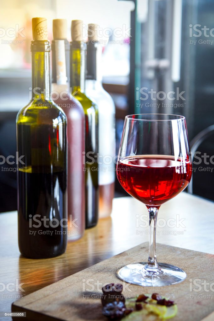 Wine, glasses and bottles stock photo