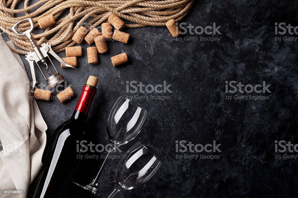 Wine, glasses and corkscrew stock photo