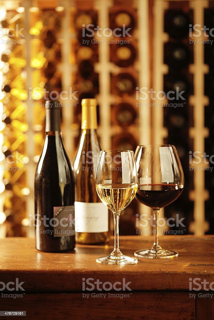 Wine Glasses, Bottle and Racks in Cellar Vertical royalty-free stock photo