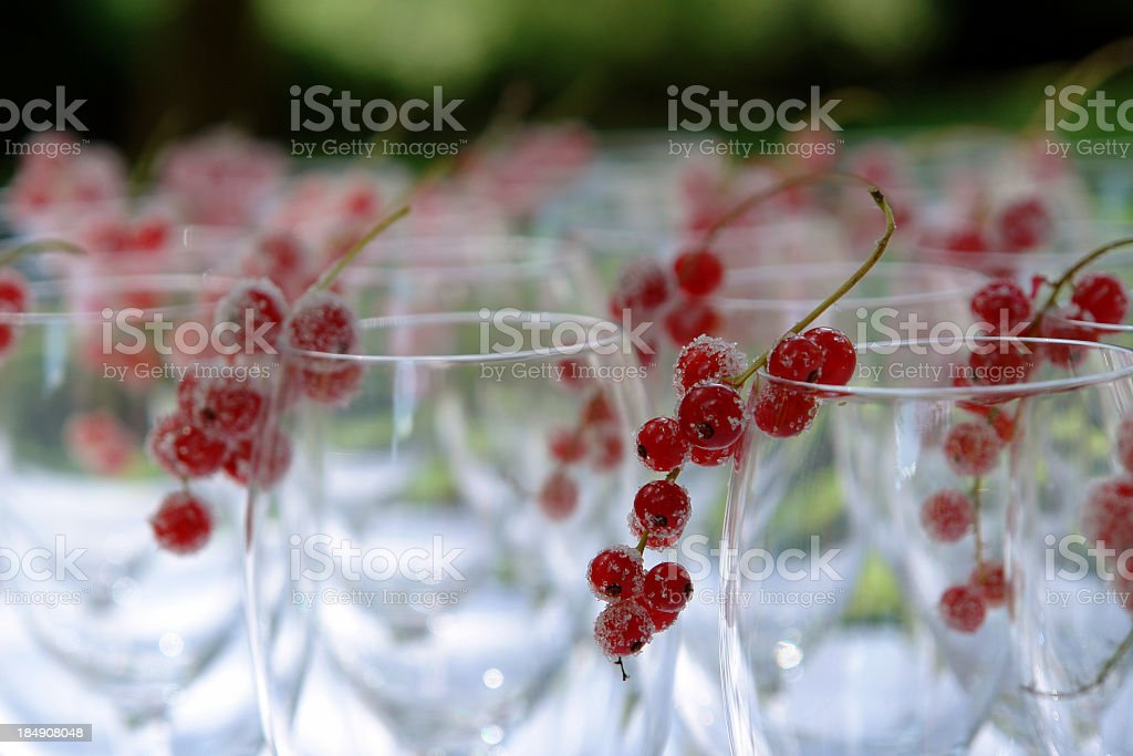 Wine glasses decorated with frosted red currants royalty-free stock photo