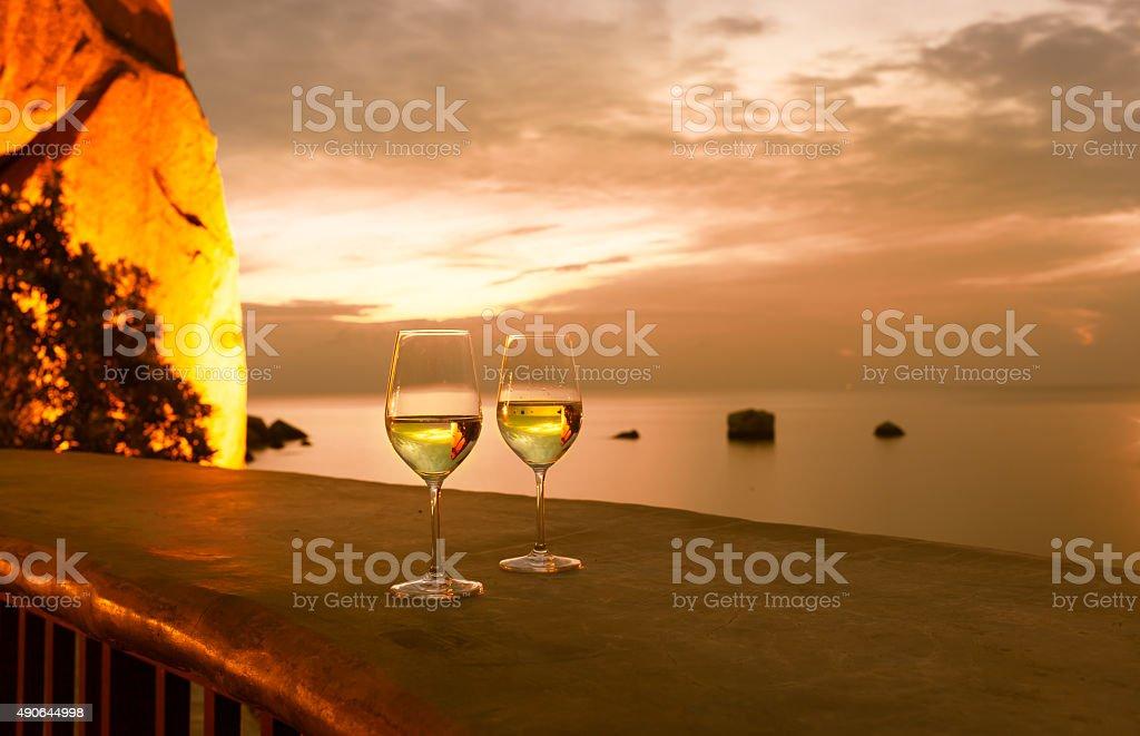Wine glasses next to a beautiful setting stock photo