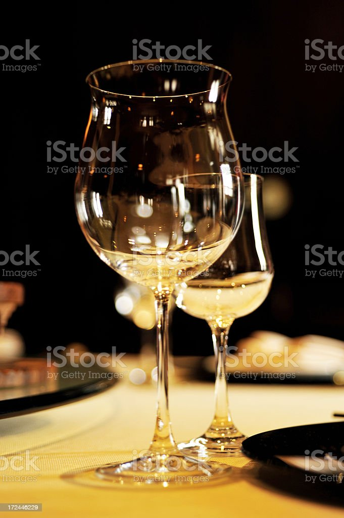 wine glasses on a luxurious dinner table royalty-free stock photo