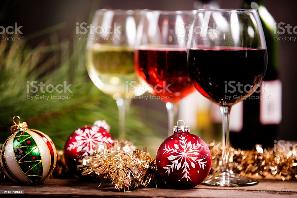 Wine, glasses on rustic outdoor dining table. Christmas ornaments. stock photo