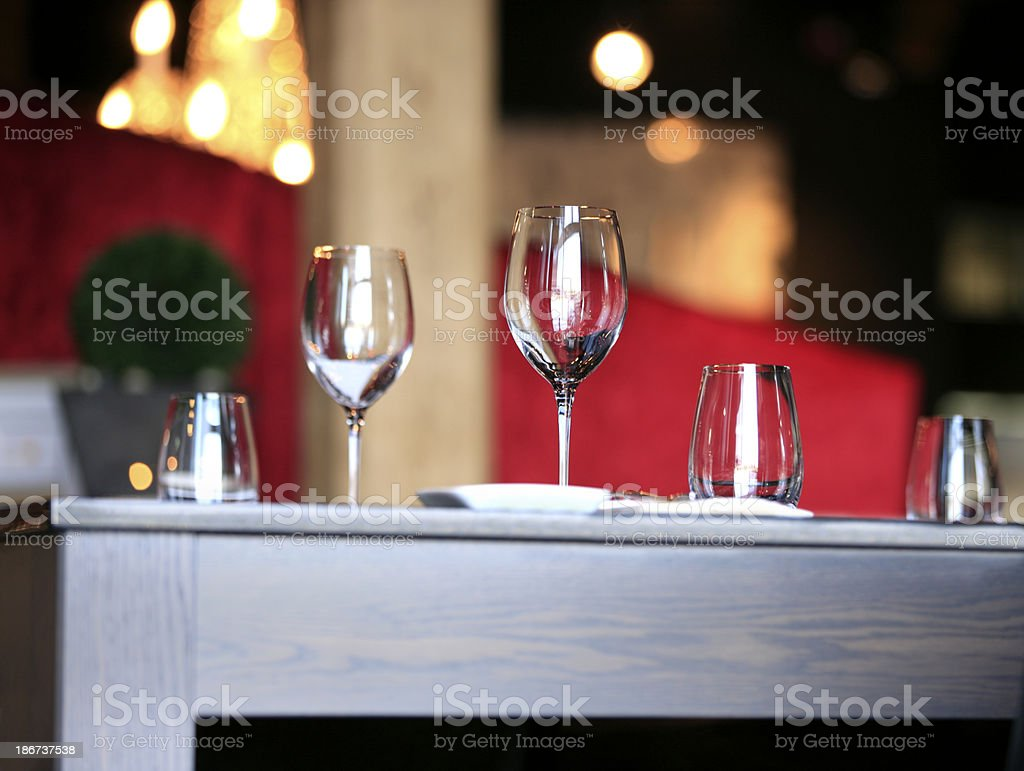 Wine glasses on table in restaurant. royalty-free stock photo
