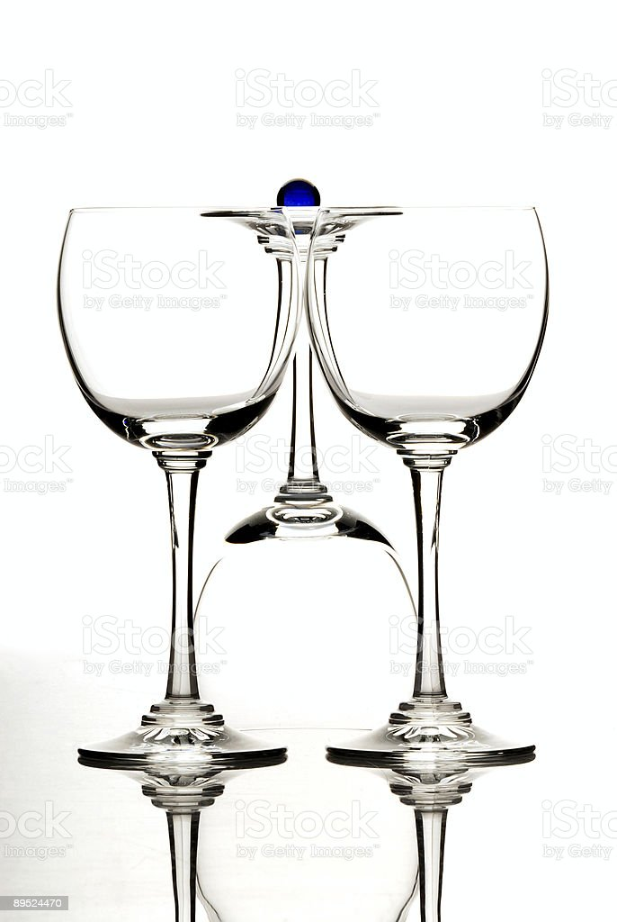 Wine glasses one upside down with navy blue crystal ball royalty-free stock photo