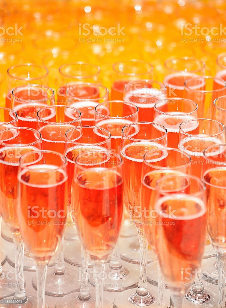 wine glasses with juice on table stock photo