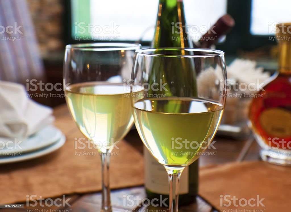 Wine goblets on restaurant table royalty-free stock photo