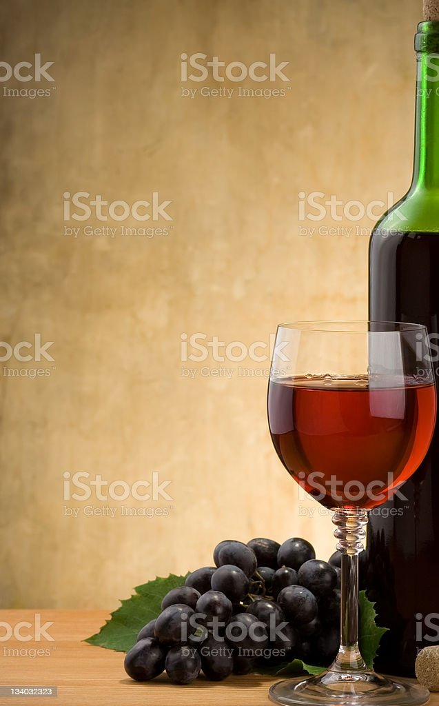 wine in glass and bottle with grape fruit royalty-free stock photo