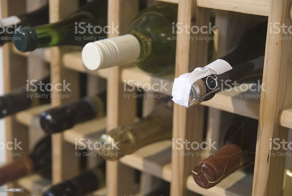 wine in rack  winerack - weinregal mit Weinflaschen stock photo