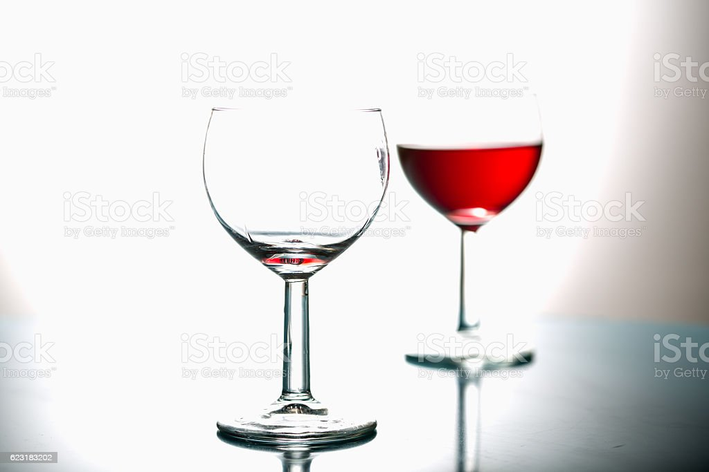 Wine in the glasses, light background stock photo