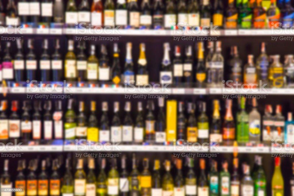 Wine Liquor bottle on shelf, Blurred Bar Restaurant background stock photo