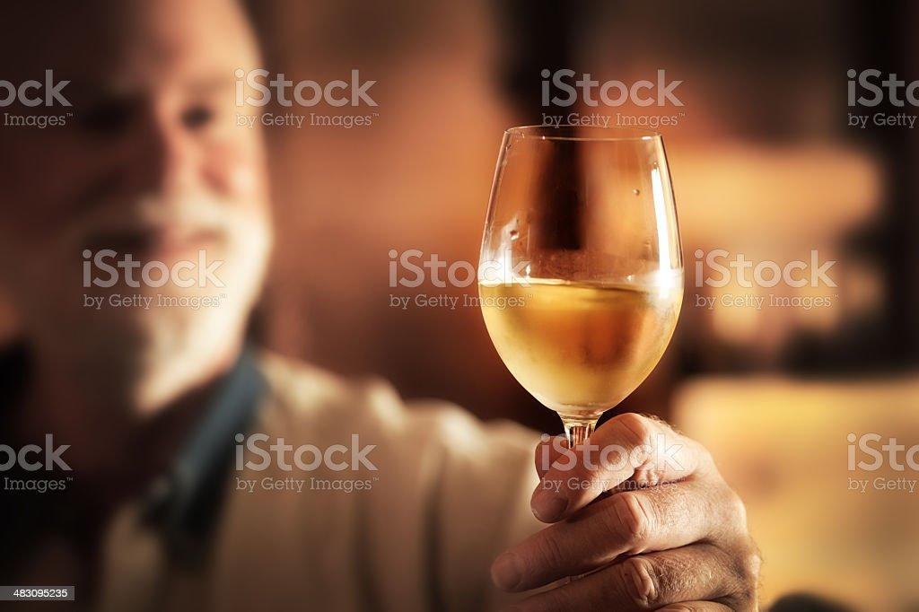 Wine Maker Taster Tasting Glass of Chilled White Wine Hz stock photo