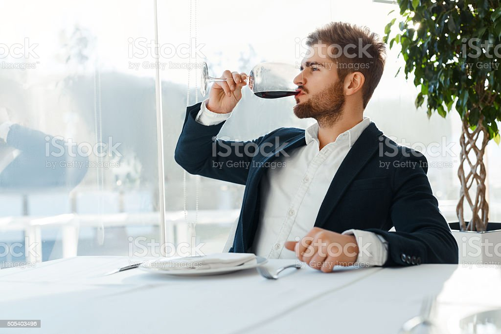 Wine. Man Tasting Wine. Businessman Drinking In Restaurant.  Celebration stock photo