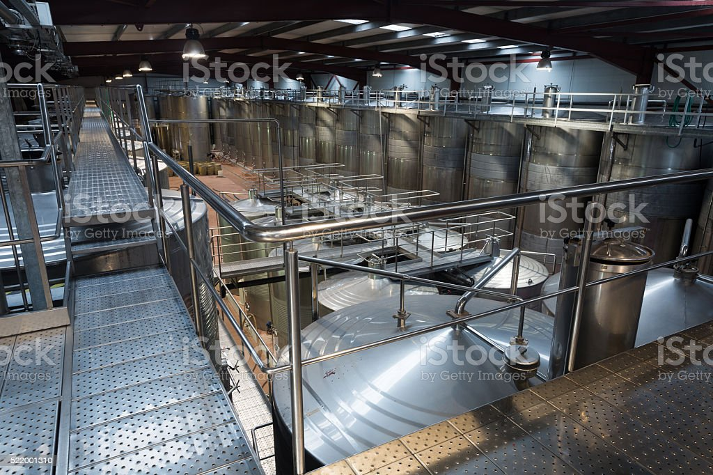 Wine material processing in tanks at plant stock photo