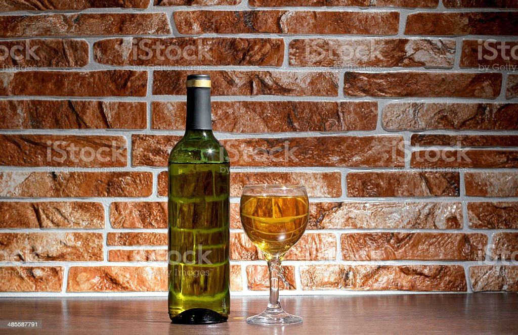 Wine of bottle on brick stock photo