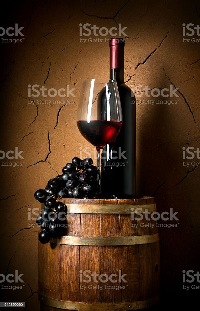 Wine on barrel in cellar stock photo