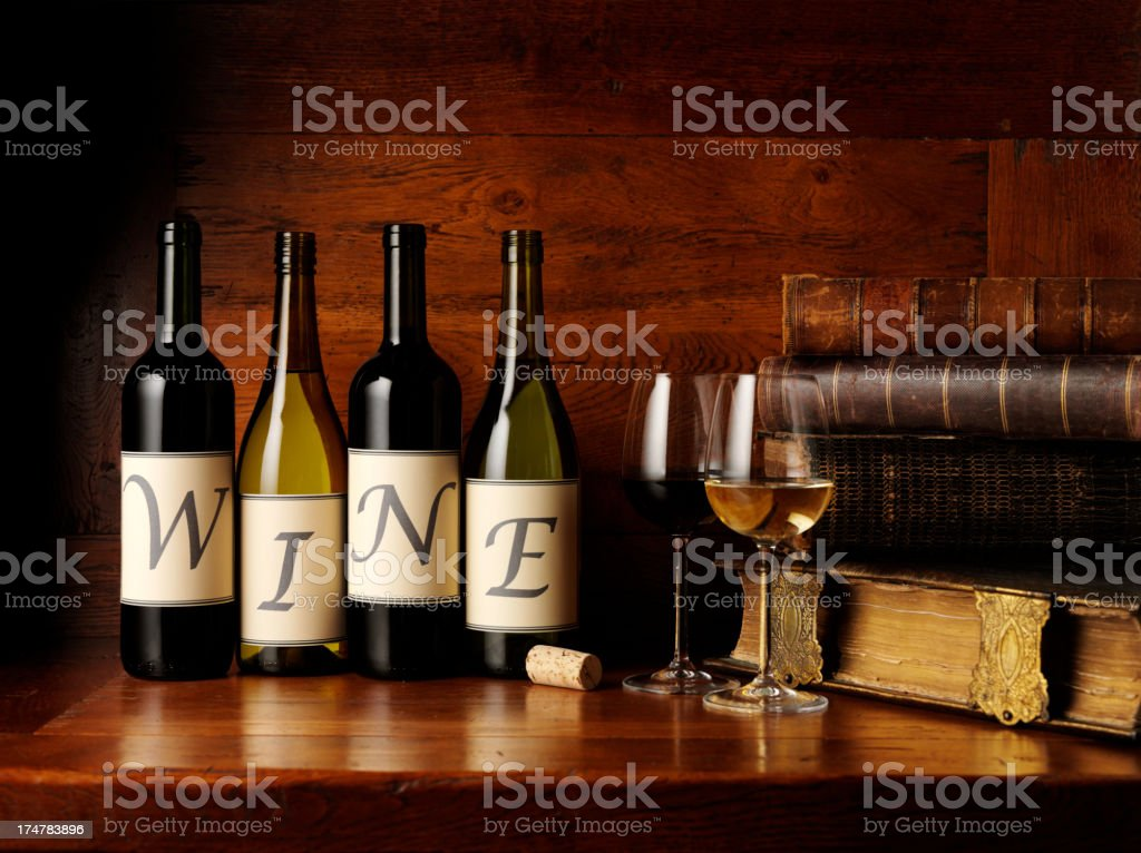 Wine on Bottles with Glasses and Books royalty-free stock photo