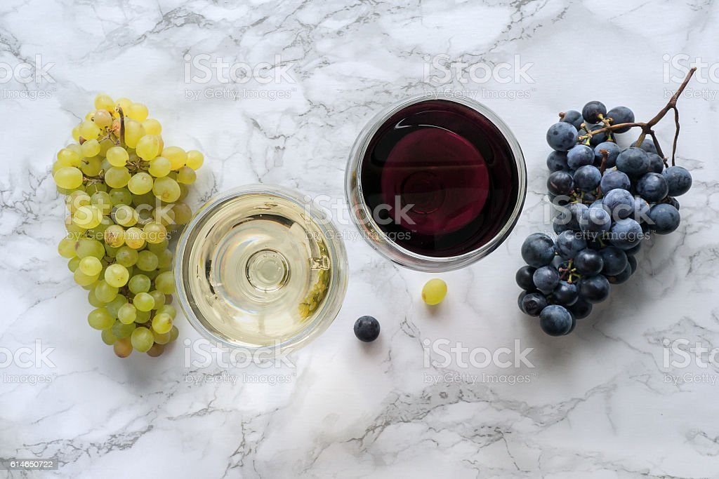 Wine on marble table stock photo