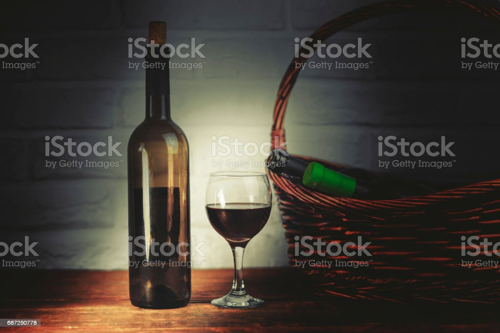 wine on the glass and bottols on basket stock photo
