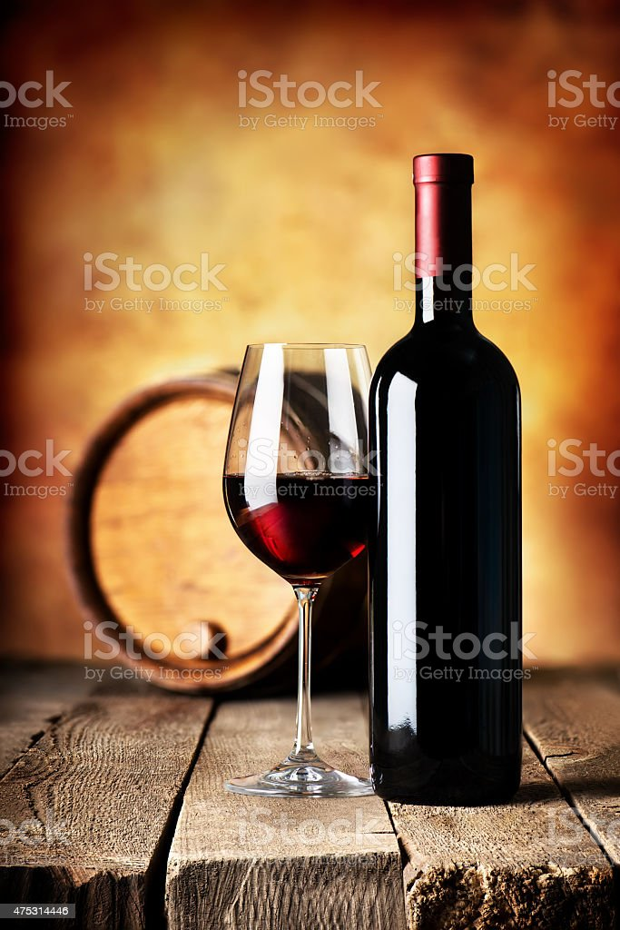 Wine on wooden table stock photo
