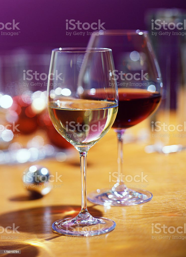 Glass of red and white wine in a festive party setting.