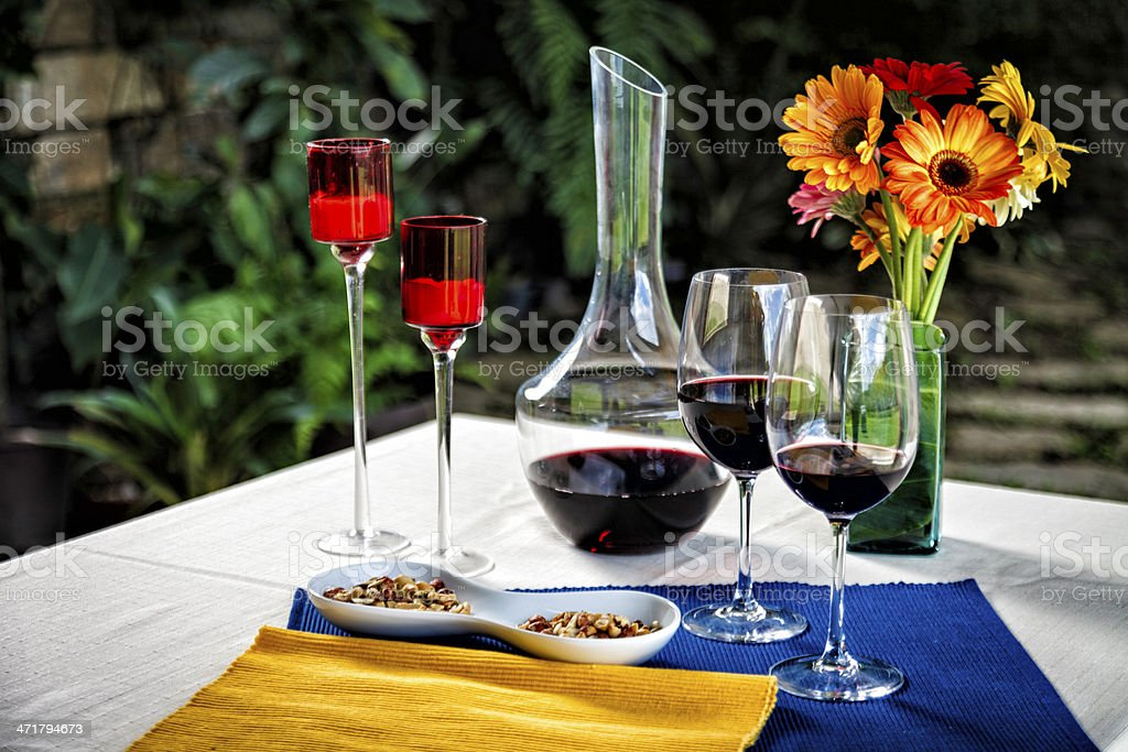 Wine peanut appetizers on lovely table setting  at home garden royalty-free stock photo
