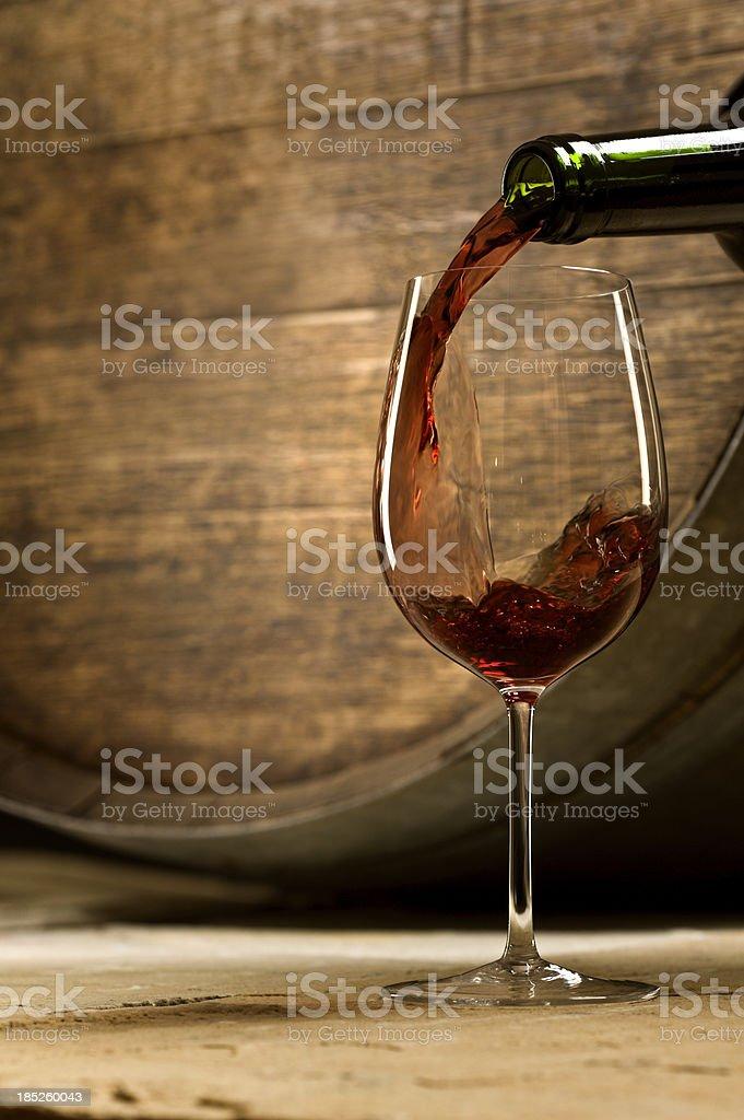Wine Pour in Cellar stock photo