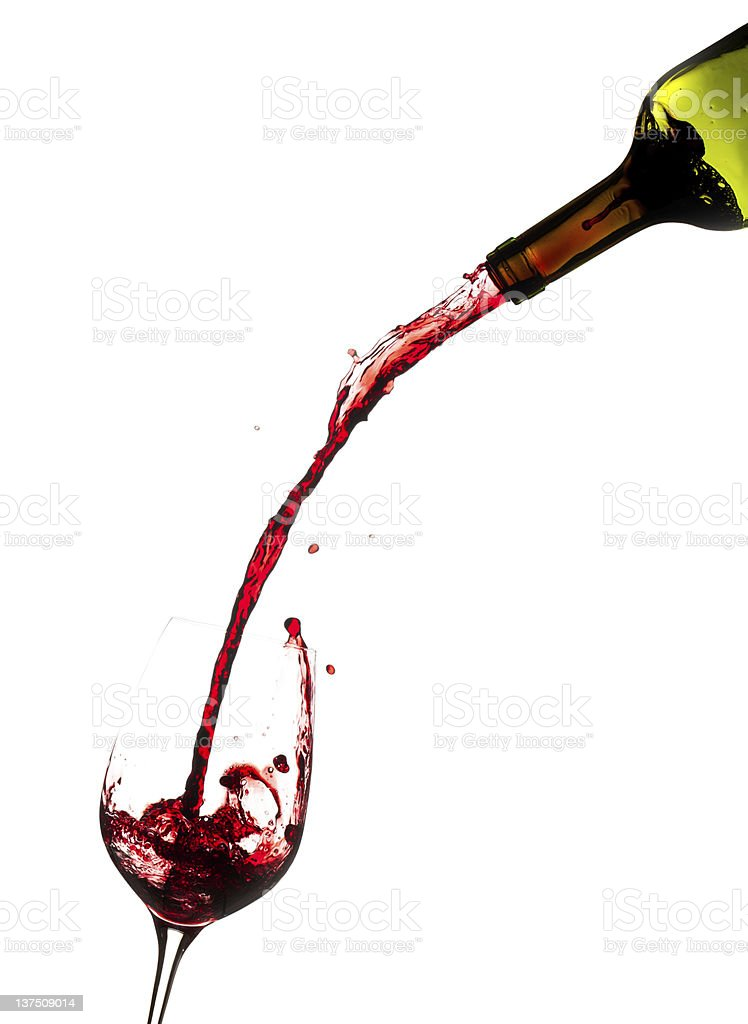 Wine pouring from bottle into glass stock photo