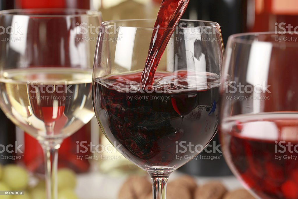 Wine pouring into a glass stock photo