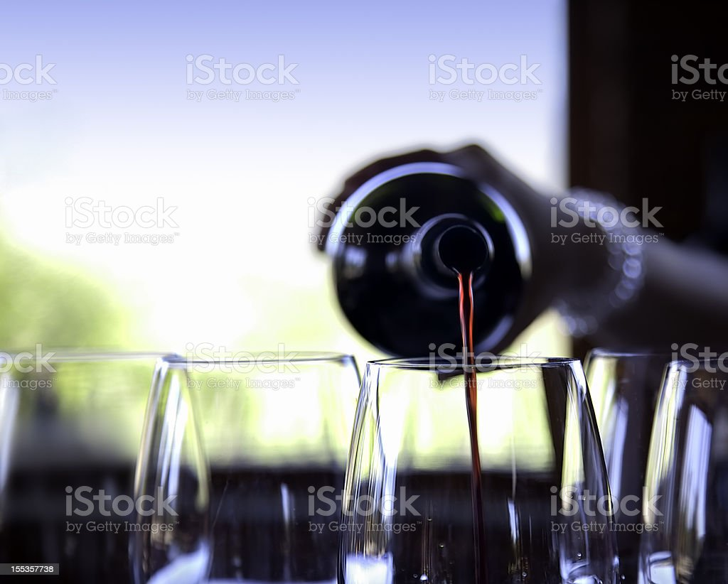 Wine pouring stock photo
