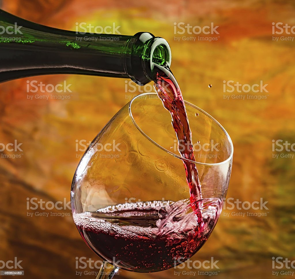 Wine pours into the glass of bottle royalty-free stock photo