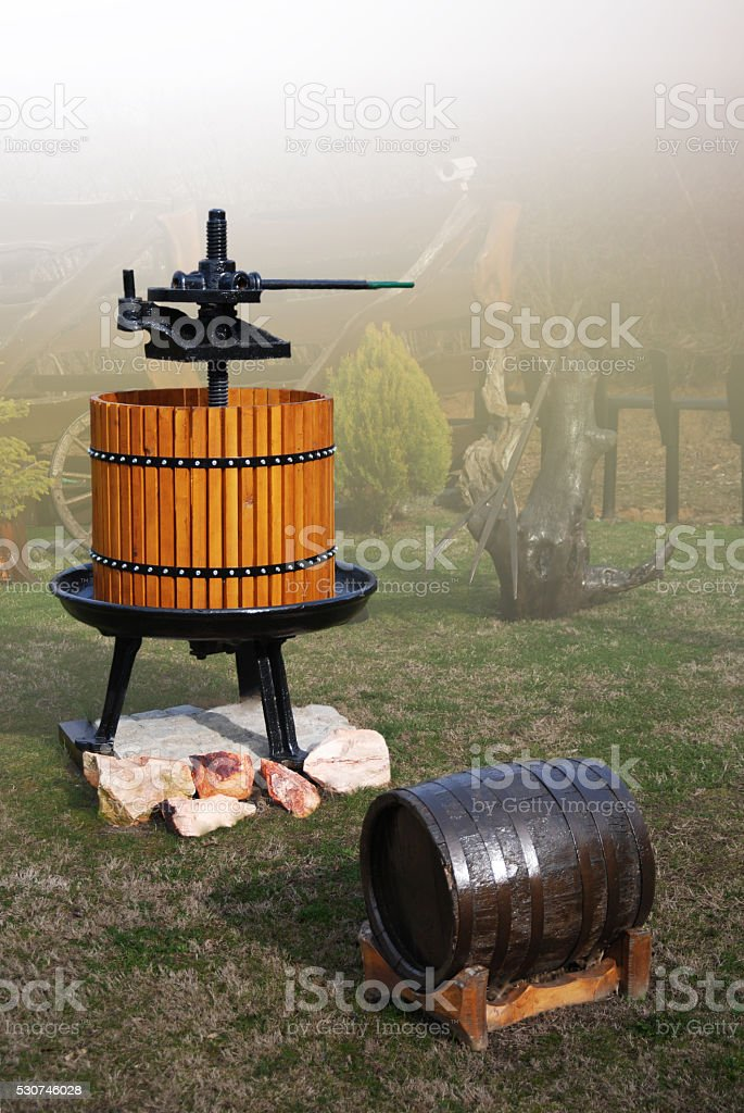 Wine press and barrel stock photo
