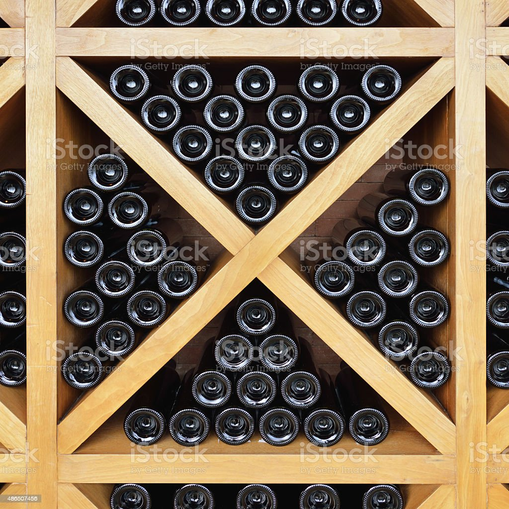 Wine Rack and Wine Bottles stock photo