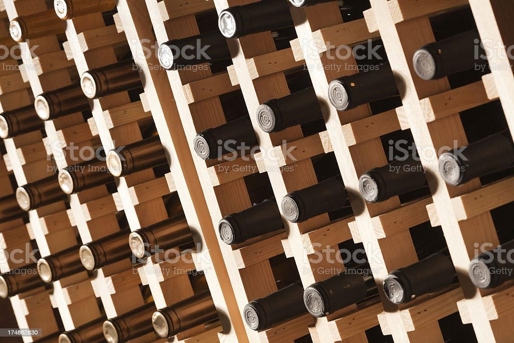 Wine Rack Filled with Bottles at Angle royalty-free stock photo