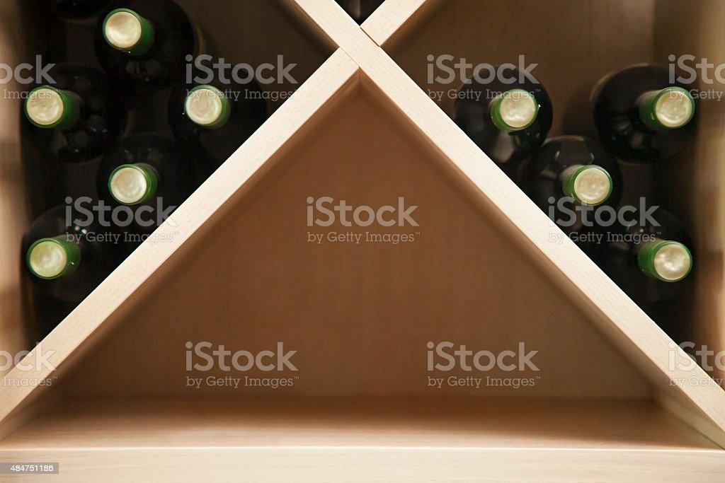 Wine rack with wine bottles. stock photo