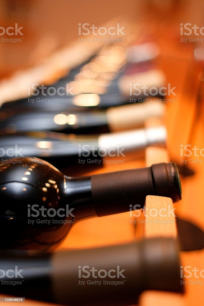Wine rack with wood and bottles royalty-free stock photo