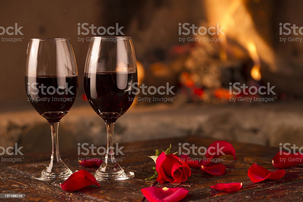 wine, roses and fire stock photo