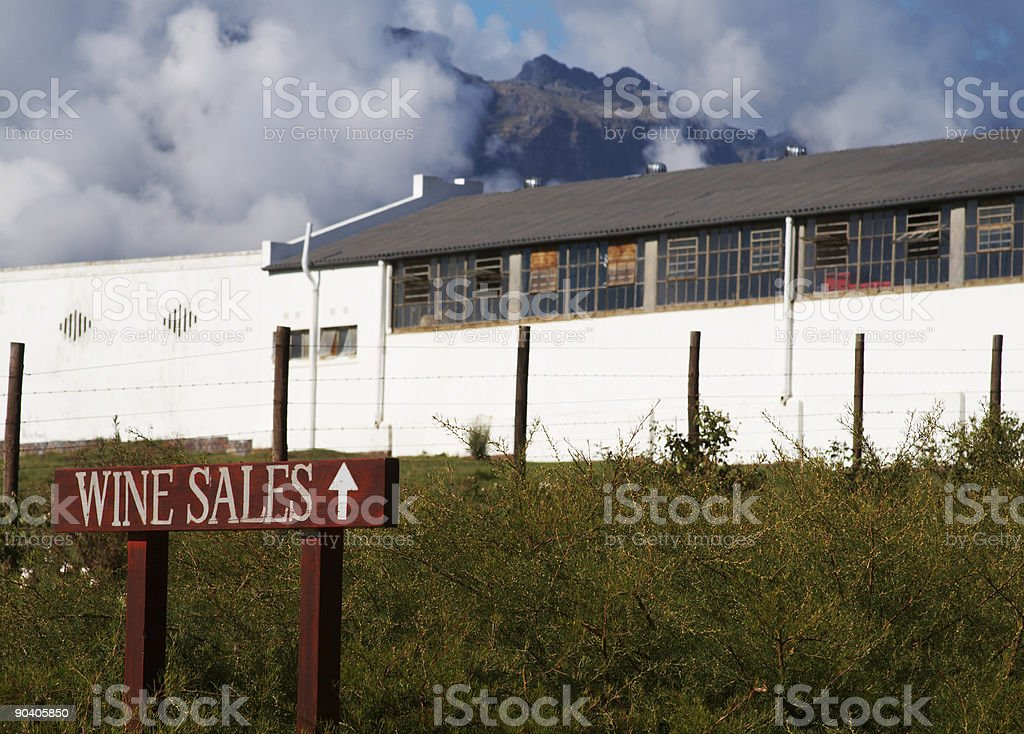 Wine sales sign next to a building on the farm stock photo