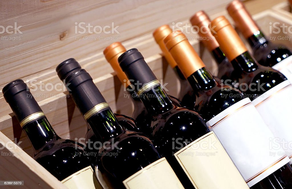 wine shop on display in the chest in the bottle of wine stock photo