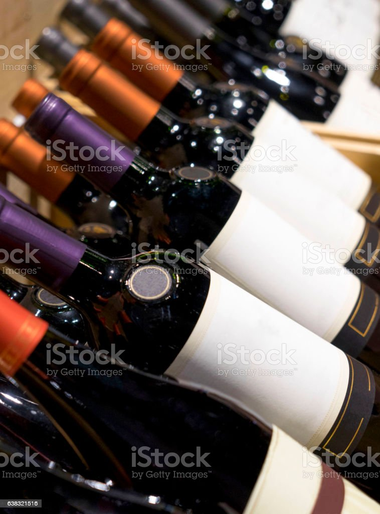 wine shop. wine bottles on display in the chest stock photo