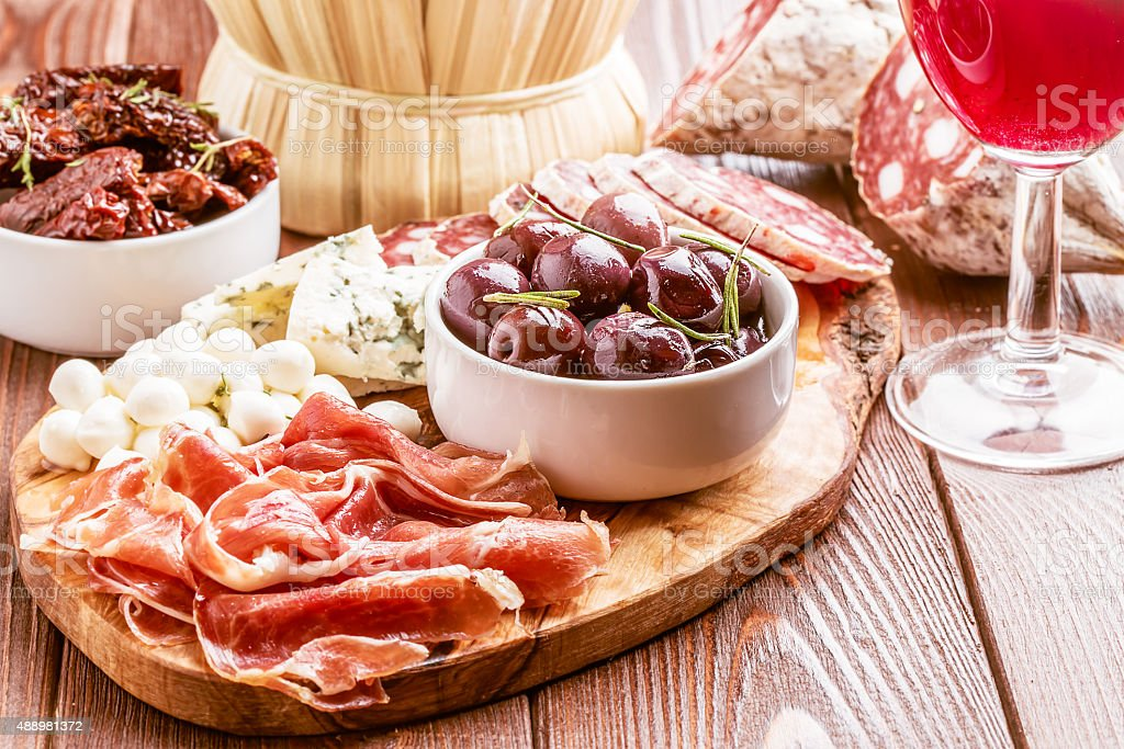 Wine snack set. Variety of cheese and meat. stock photo