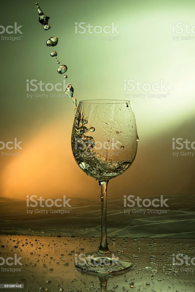 wine splash out of a wine glass stock photo